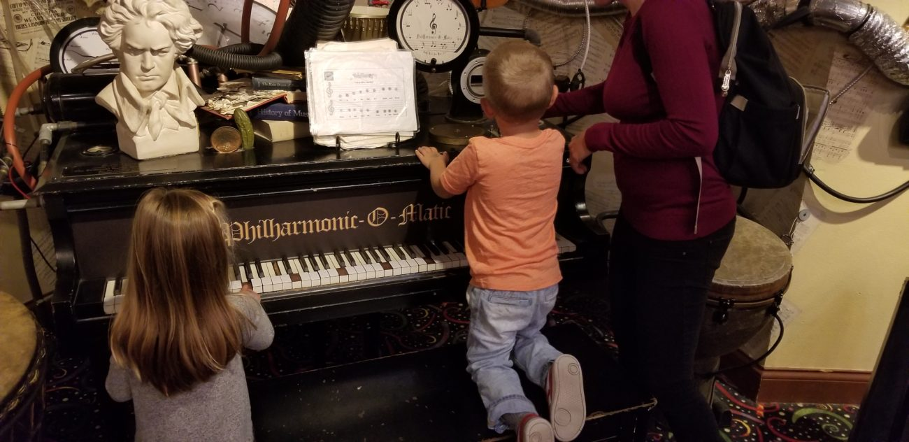 picture of child playing the piano at Pennypickle's workshop in temecula, CA